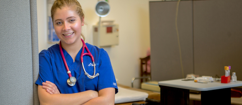 A medical student smiling at the camera. Looking for a Nursing program? Call Beal.