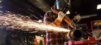 A Beal welding student welding with sparks flying eerywhere