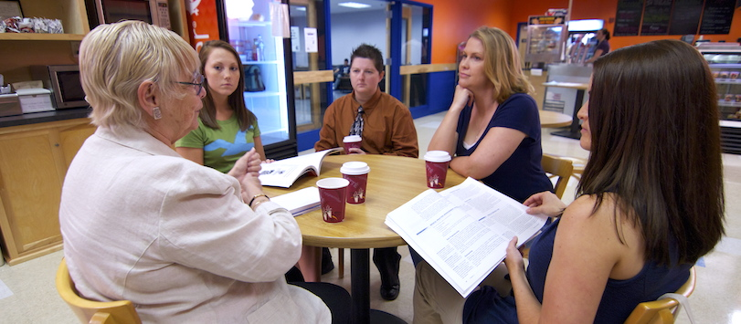 A study group working together. To learn more about Beal's accelerated degree programs give us a call.
