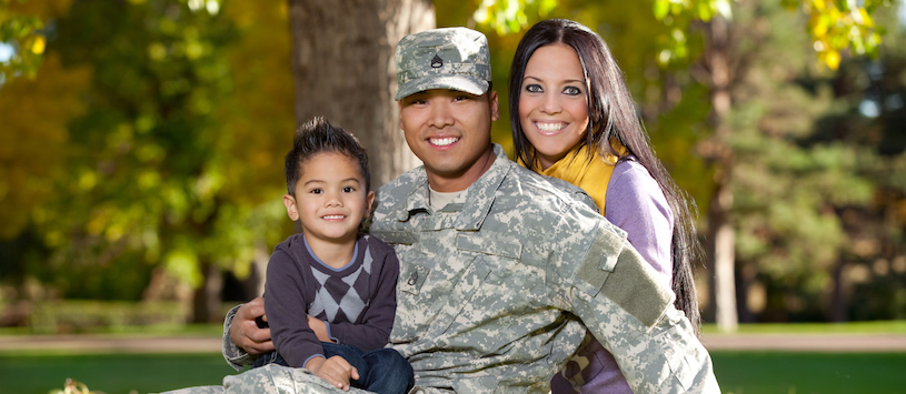 A smiling veteran and his family. For info about the gi bill contact Beal.