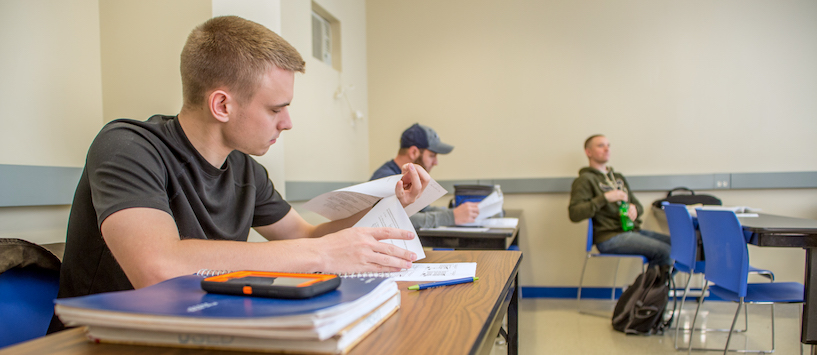 A male student studying. Transfer students can use their credits at Beal. Call to learn more.